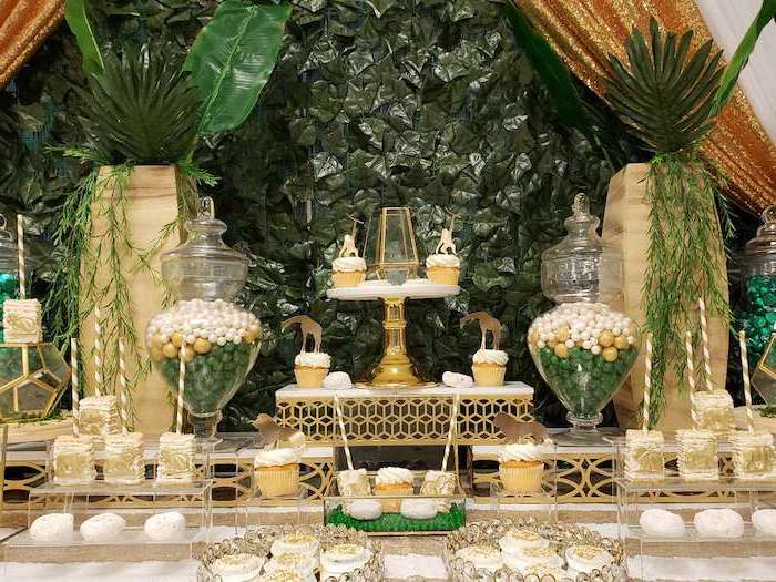 greenery background, baby shower centerpieces boy, cake pops and cupcakes on the table and glass stands