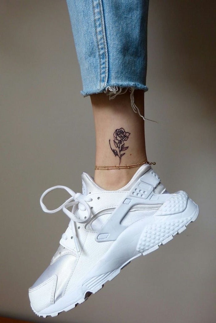 rose tattoo on the ankle, white sneakers, tattoos for girls, grey background