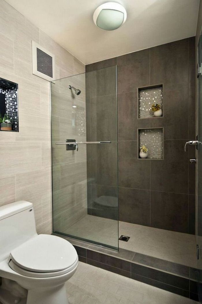 grey tiled walls and floor, built in shelves, how to decorate a bathroom, glass shower door