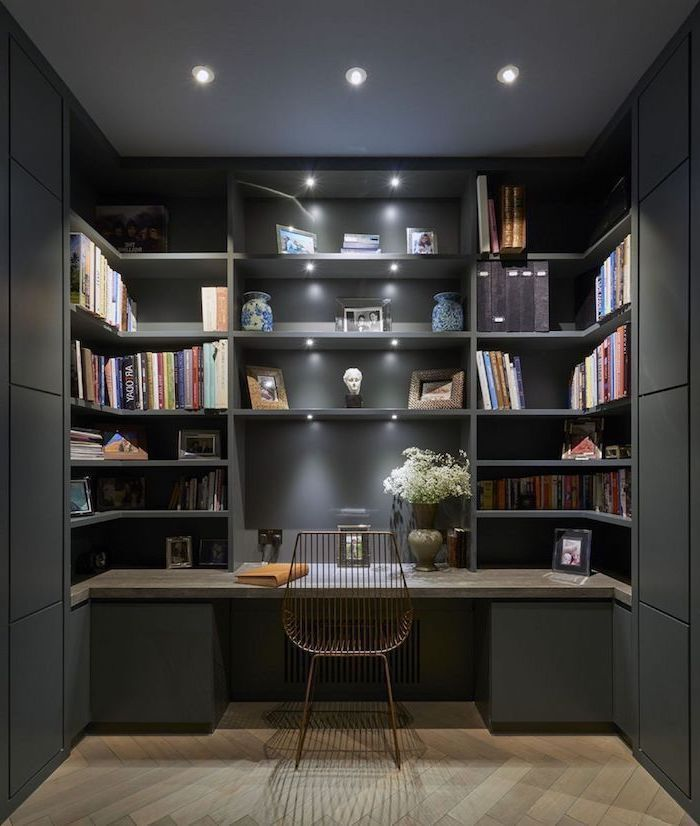 black bookcase with shelves and cabinets, wooden desk, home office setup, metal chair