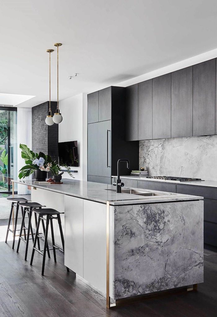 marble kitchen island, grey cabinets, wooden floor, black stools, kitchen remodel