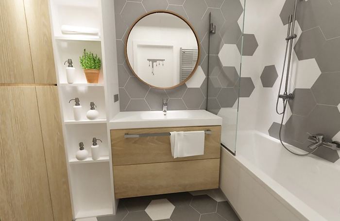 grey honeycomb tiled walls and floor, floating wooden shelves, how to decorate a bathroom, oval mirror