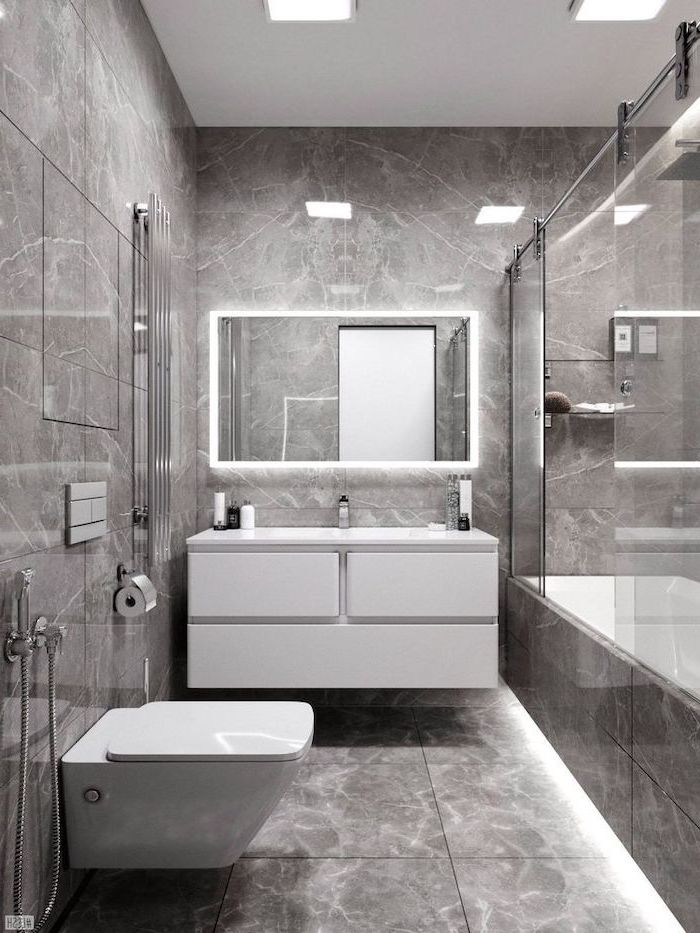 marble tiled walls and floor, led lights, small bathroom remodel ideas, white floating cabinets