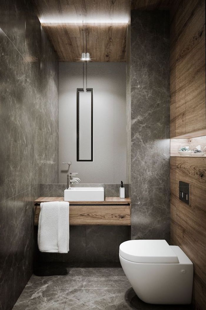 grey marble tiled walls and floor, bathroom remodel ideas, wooden floating shelves