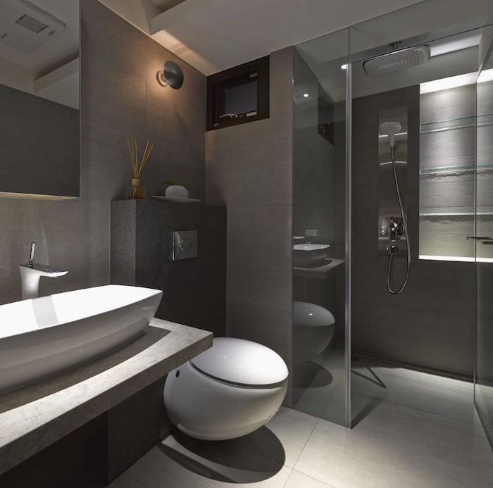 grey tiled walls and floor, glass shower door, bathroom remodel ideas, floating marble sink
