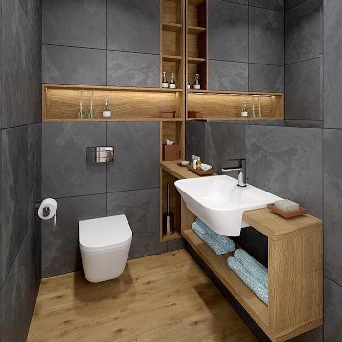 grey tiled walls, wooden floor, how to decorate a bathroom, floating and built in wooden shelves