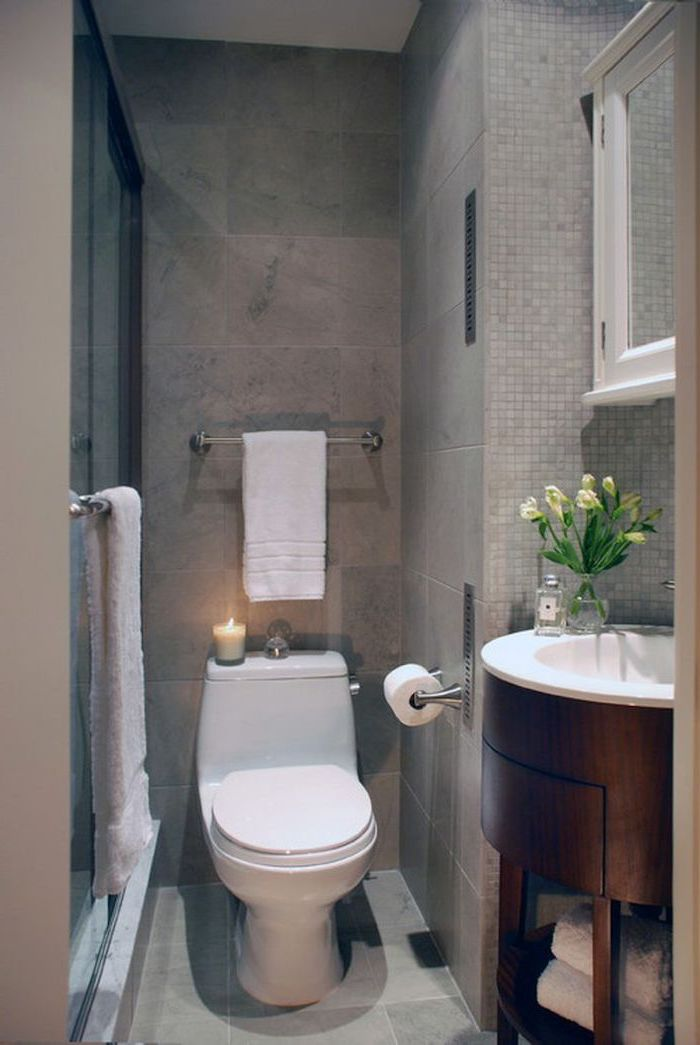 small bathroom layout, grey mosaic tiled walls and floor, oval wooden floating cabinet and sink