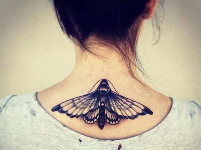 flying moth, tattoo on the back, grey top, small meaningful tattoos, white background