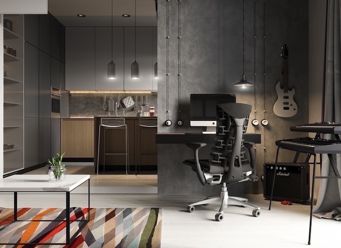 dark grey walls, black wooden desk with black chair, music instruments, colourful rug, small home office ideas