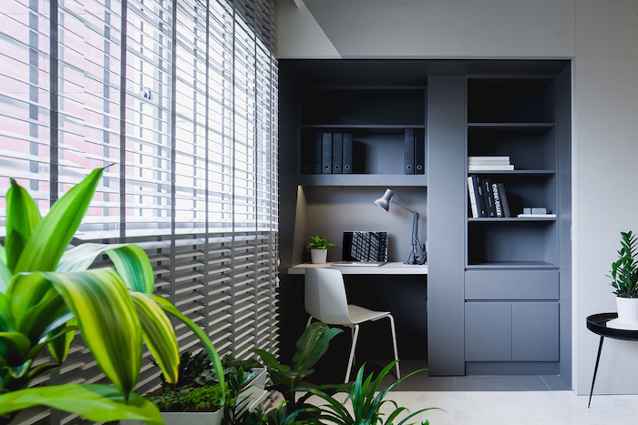 grey bookcase with shelves and cupboards, white desk and chair, desk ideas