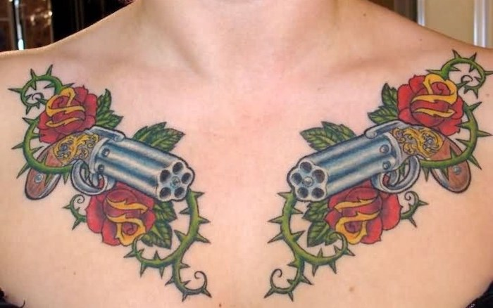 two guns, red roses and green thorns on both shoulders, small chest tattoos