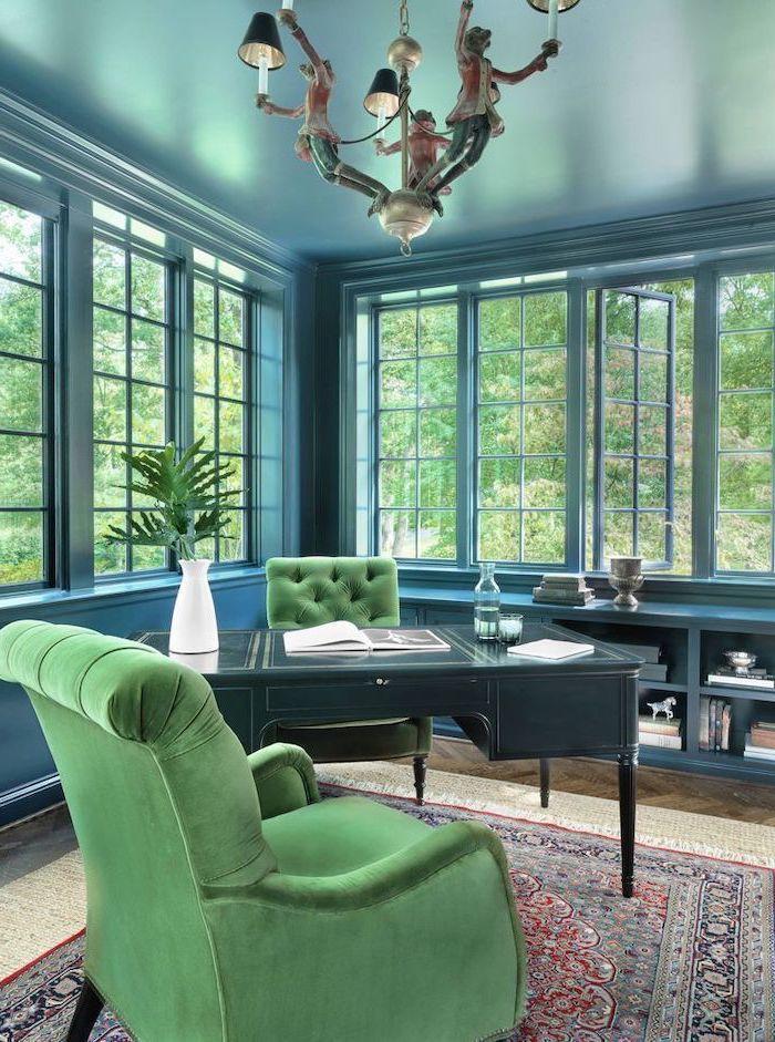 hanging chandelier, desk ideas, turquoise walls and desk, green velvet armchairs, vintage rug