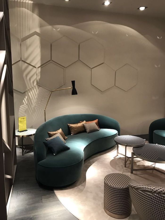 honeycomb geometrical wall installation, wall designs, turquoise velvet sofa, standing light