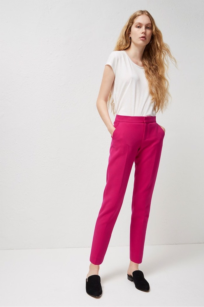 hot pink trousers, black loafers, business casual attire, white short, long blonde hair