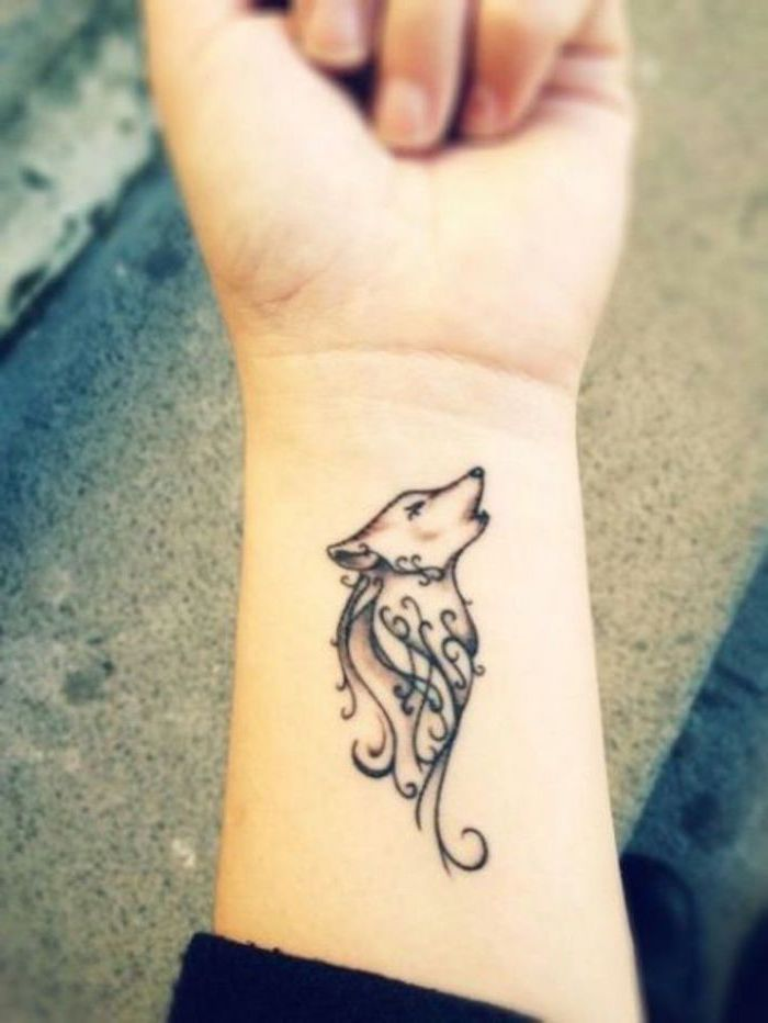 howling wolf, tattoo on the wrist, small tattoo ideas for women, grey background