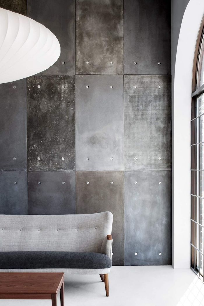 grey and black sofa, wall painting ideas, industrial metal tiles on the wall, wooden coffee table