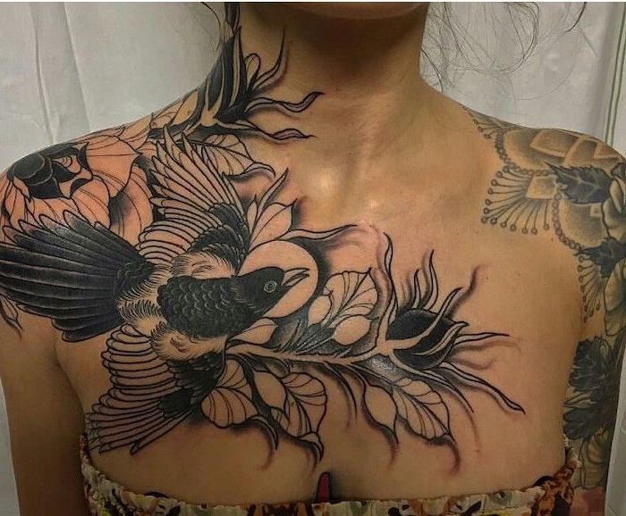 large hummingbird, flowers and leaves on the shoulders, small chest tattoos, floral top