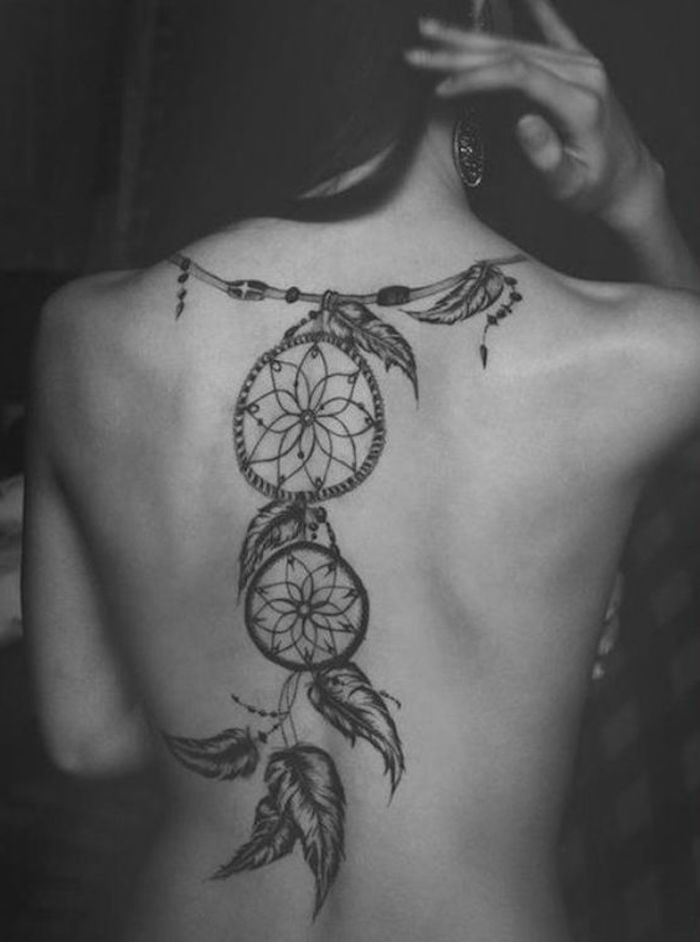 dreamcatcher tattoo on the back, tattoo designs for women, black background