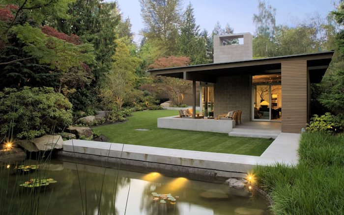 large grass patch, small pond with lilies, tall trees, landscape lighting ideas, patches of grass