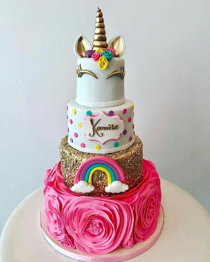 large pink roses, gold layer with rainbow, unicorn cake pictures, gold horn and ears