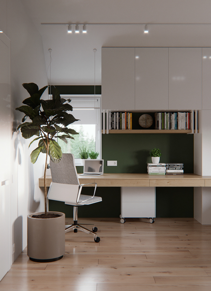 white cupboards, home office decor, wooden bookshelf and desk, white and grey chair, large plant in a pot