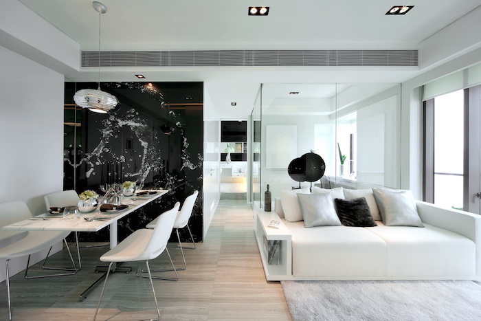 black and white glass wall, white sofa and rug, best colors for living room walls
