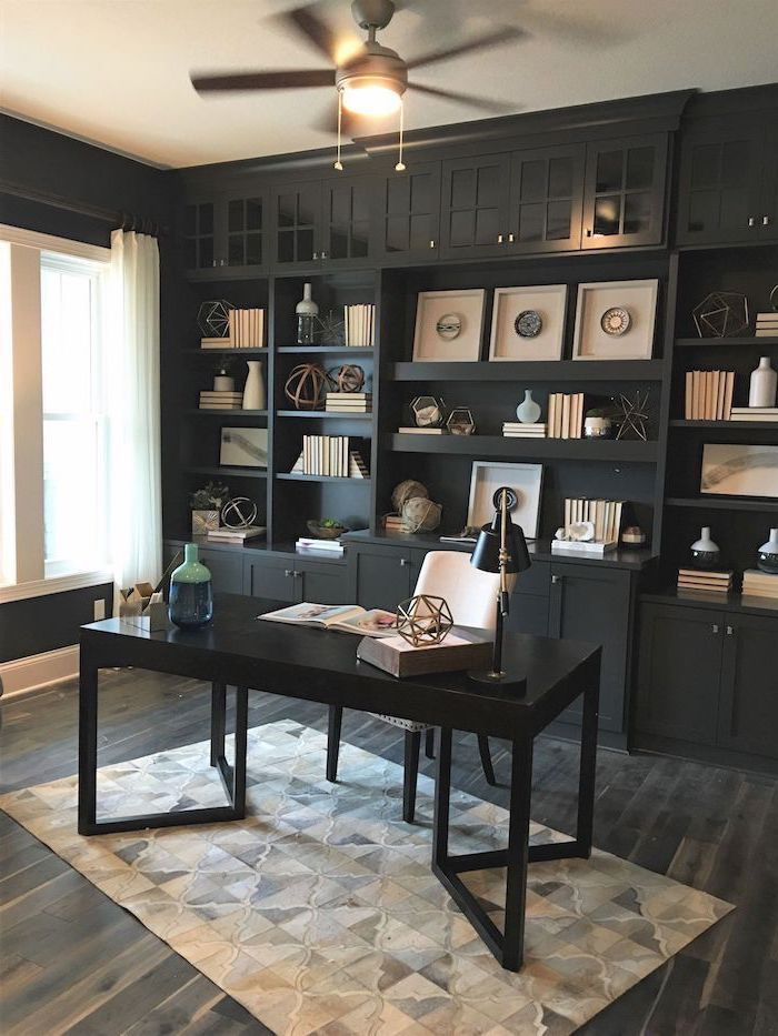 large black bookcase with cupboards and shelves, black desk with white chair, home office decor