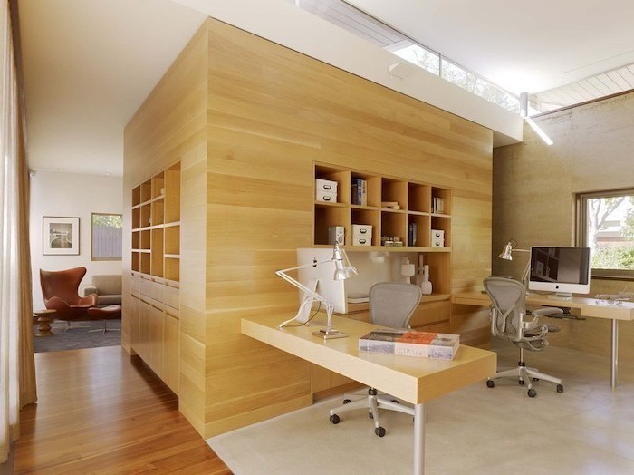 large wooden bookcase and desks, grey mesh chairs, cute office decor, brown leather armchair