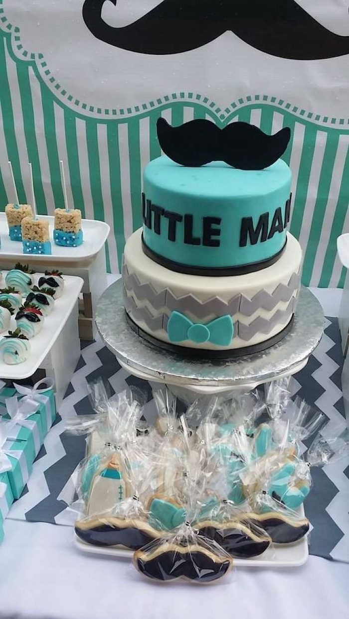 little man and moustache cake, sweets on the table, sports themed baby shower