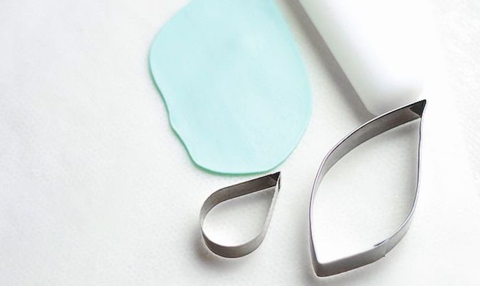 white background, metal cookie cutter shapes, how to make a unicorn horn, blue fondant