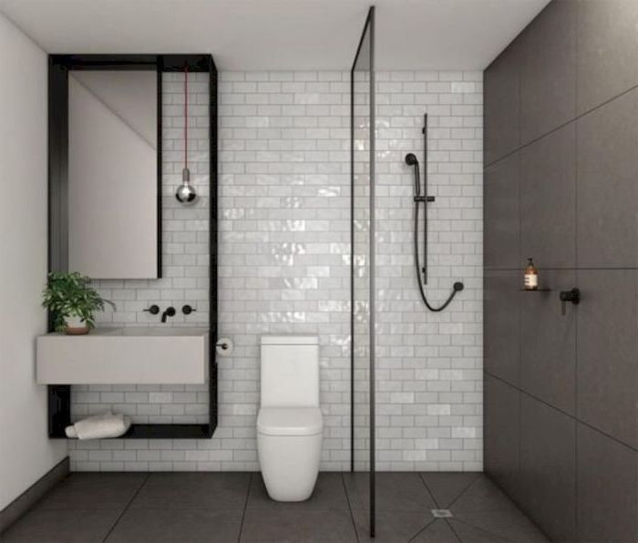 grey and white tiled walls and floor, floating white sink, small bathroom layout, small mirror