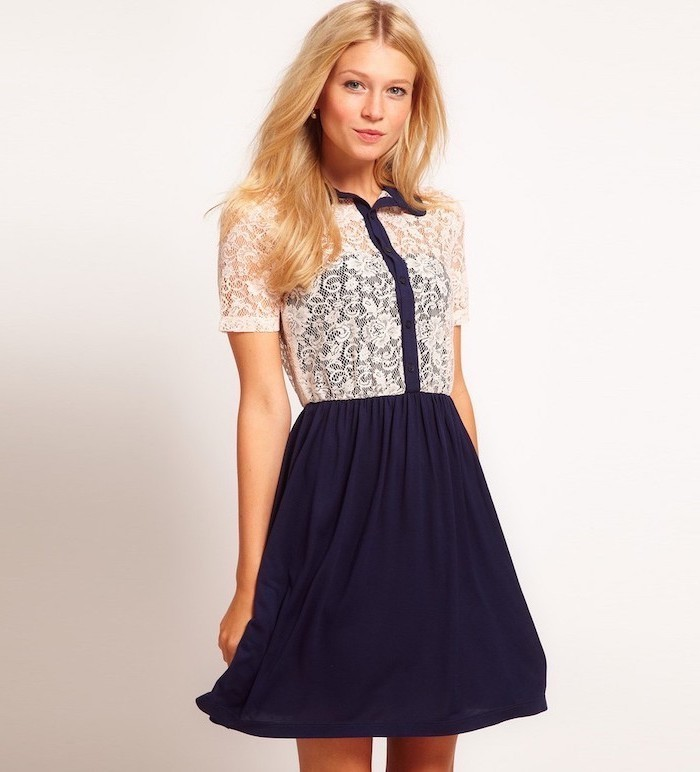 navy blue and white lace dress, long blonde hair, business professional women