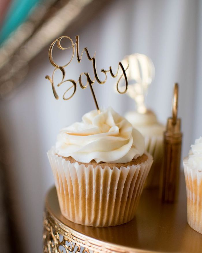 oh baby cake topper, small cupcakes, golden cake stand, sports themed baby shower