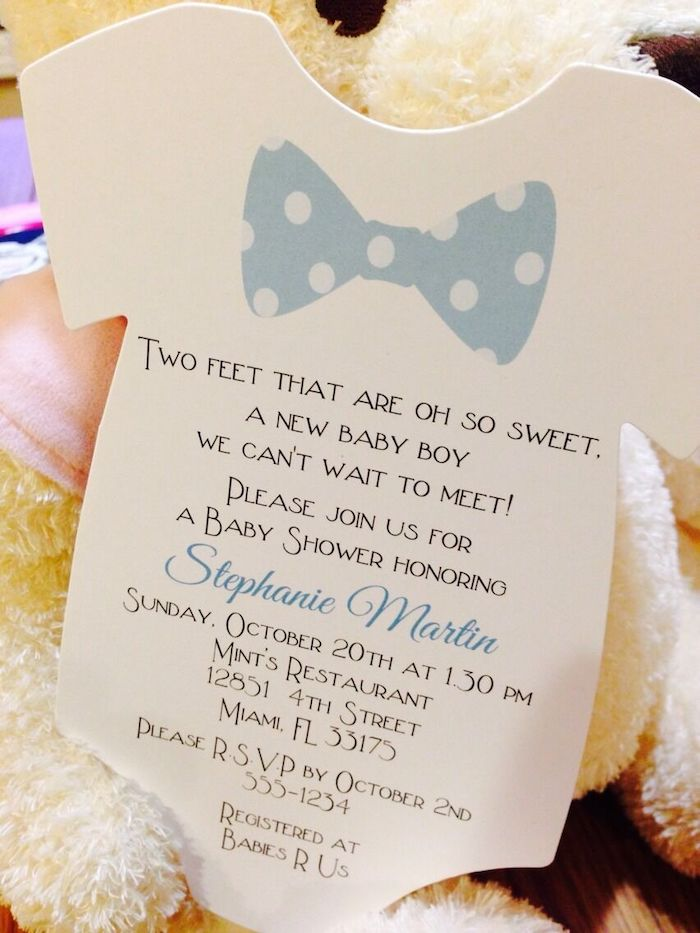 white baby onesie invitation, blue dotted bow, baby shower decoration ideas