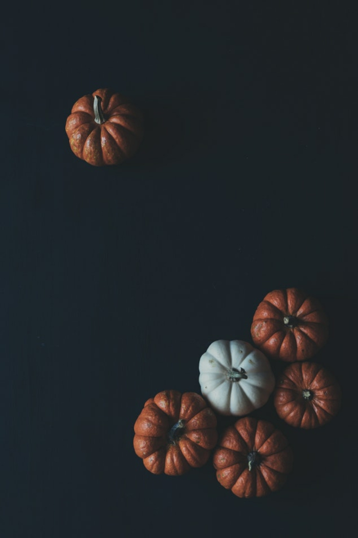 black background, motivational iphone wallpaper, orange and white pumpkins