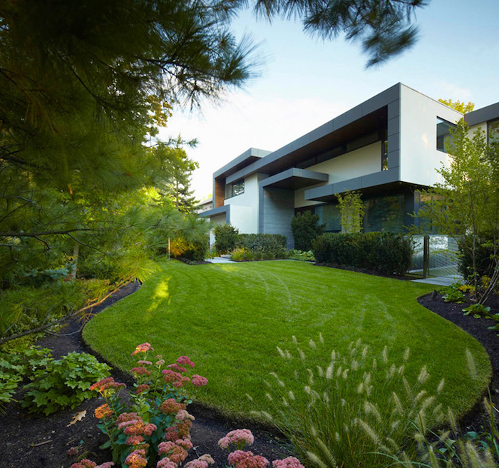 large patch of grass, flower beds, landscape design ideas, tall trees, hedges and small bushes