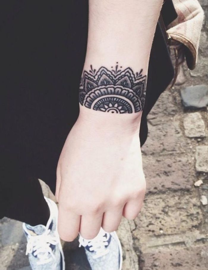 symmetrical wrist tattoo, paved path, small tattoos with meaning, black jeans and pants