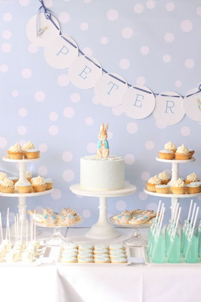 blue dotted backdrop, baby shower theme ideas, cake and sweets on the table, peter rabbit cake topper