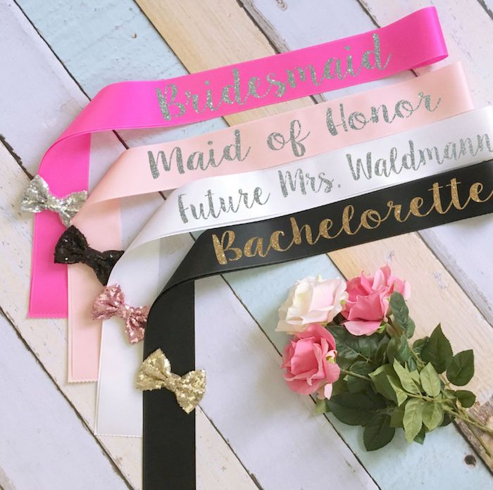 satin sashes, bows on the sashes, bouquet of roses, bachelorette ideas, wooden background