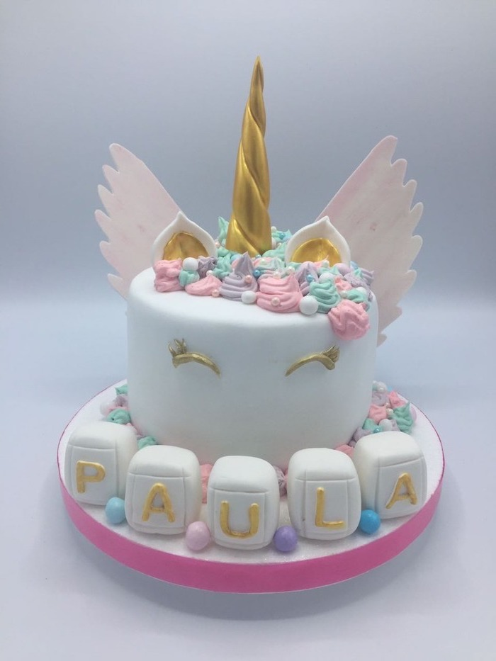 gold horn eyes and ears, unicorn cake pictures, pink wings, pink purple and green roses on white fondant