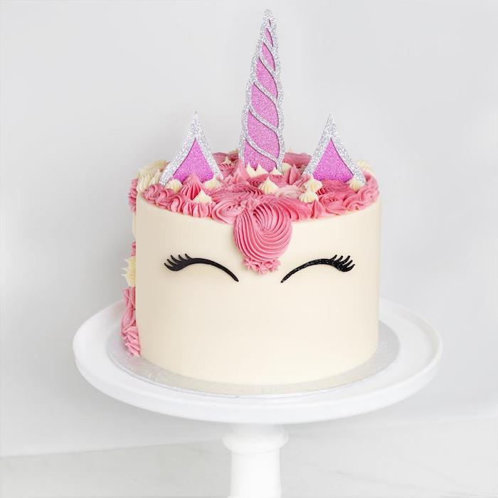pink and silver horn and ears, pink and yellow roses on white fondant, how to make a unicorn