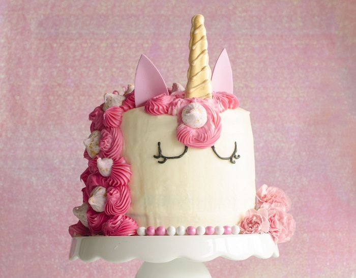 pink roses and meringue kisses on white fondant, unicorn cupcake cake, gold horn, pink ears