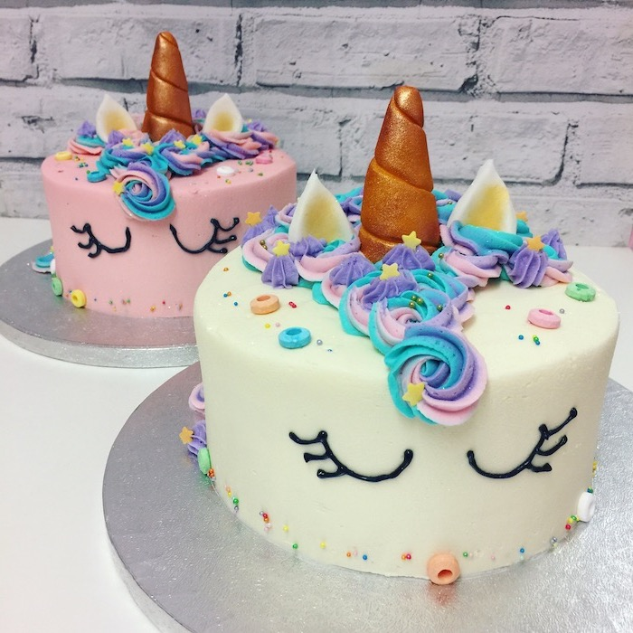 white and pink fondant, unicorn cupcake cake, pink blue and purple roses, gold horns