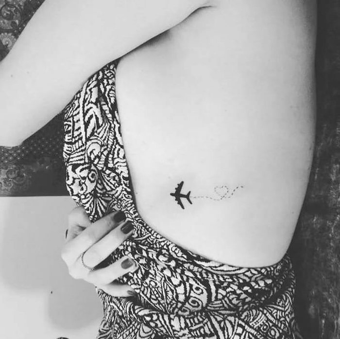 plane and a heart, tattoo on the chest, black and white top, tattoos for girls on wrist, black nail polish