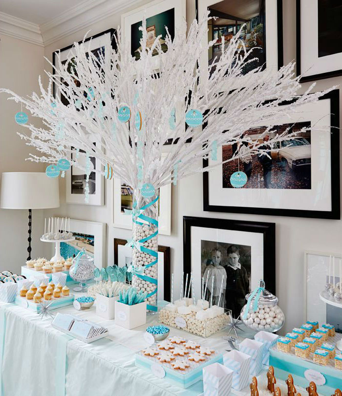 plastic white tree, sweets on the table, photo frames on the wall, blue ribbons, unique boy baby shower themes