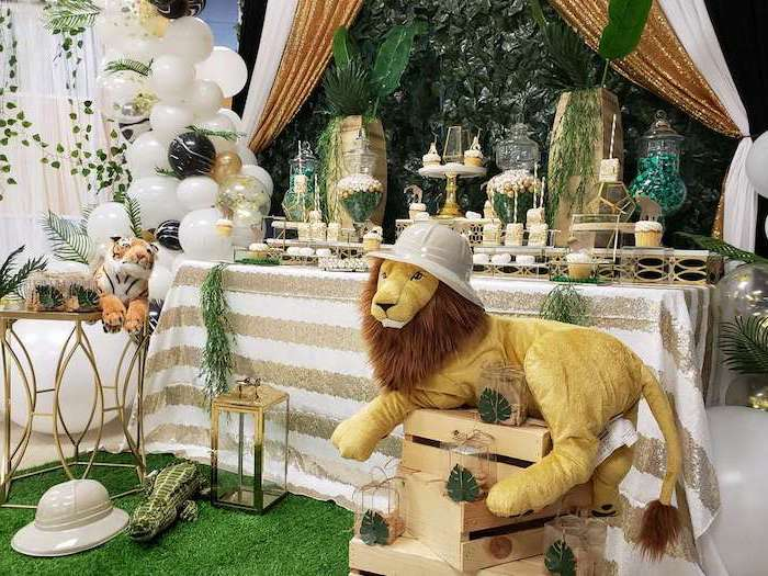 big plush lion, white balloons, sweets on the table, unique boy baby shower themes, wooden crates