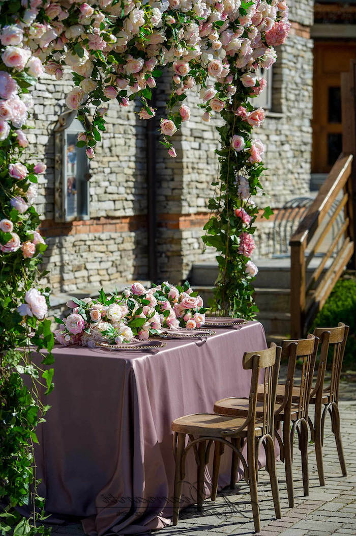 arch made of pink roses, pink and white roses flower arrangement on the table, wedding ceremony decorations