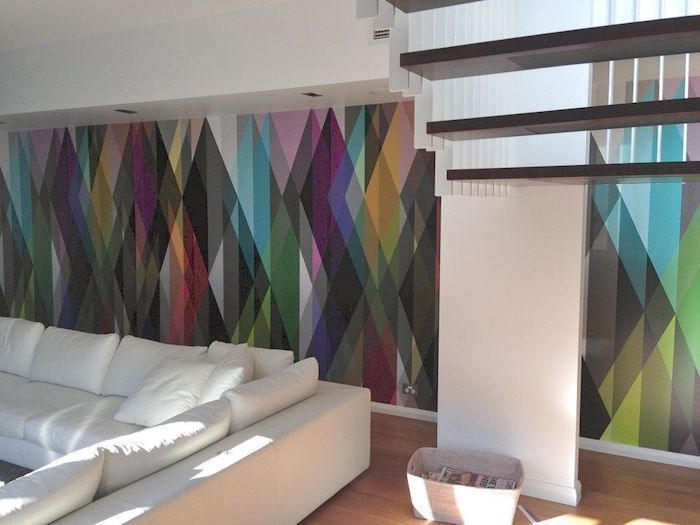 rainbow wallpaper, white corner sofa, wooden staircase, accent wall ideas bedroom