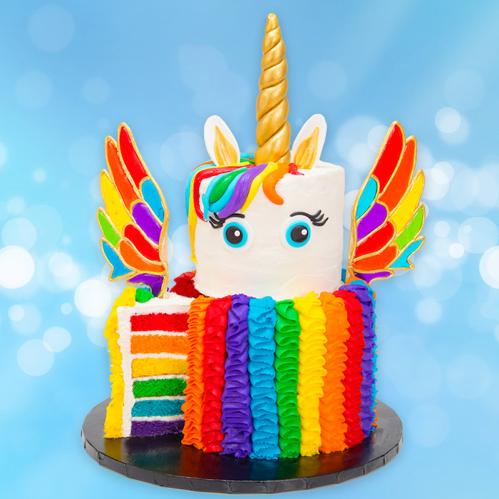 rainbow layered cake, unicorn cake ideas, rainbow coloured wings and roses, gold horn and ears