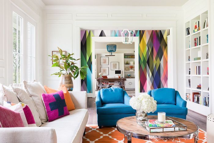 blue armchairs, white sofa, accent wall ideas bedroom, rainbow wallpaper, orange rug